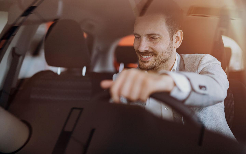 Man with a beard in a car