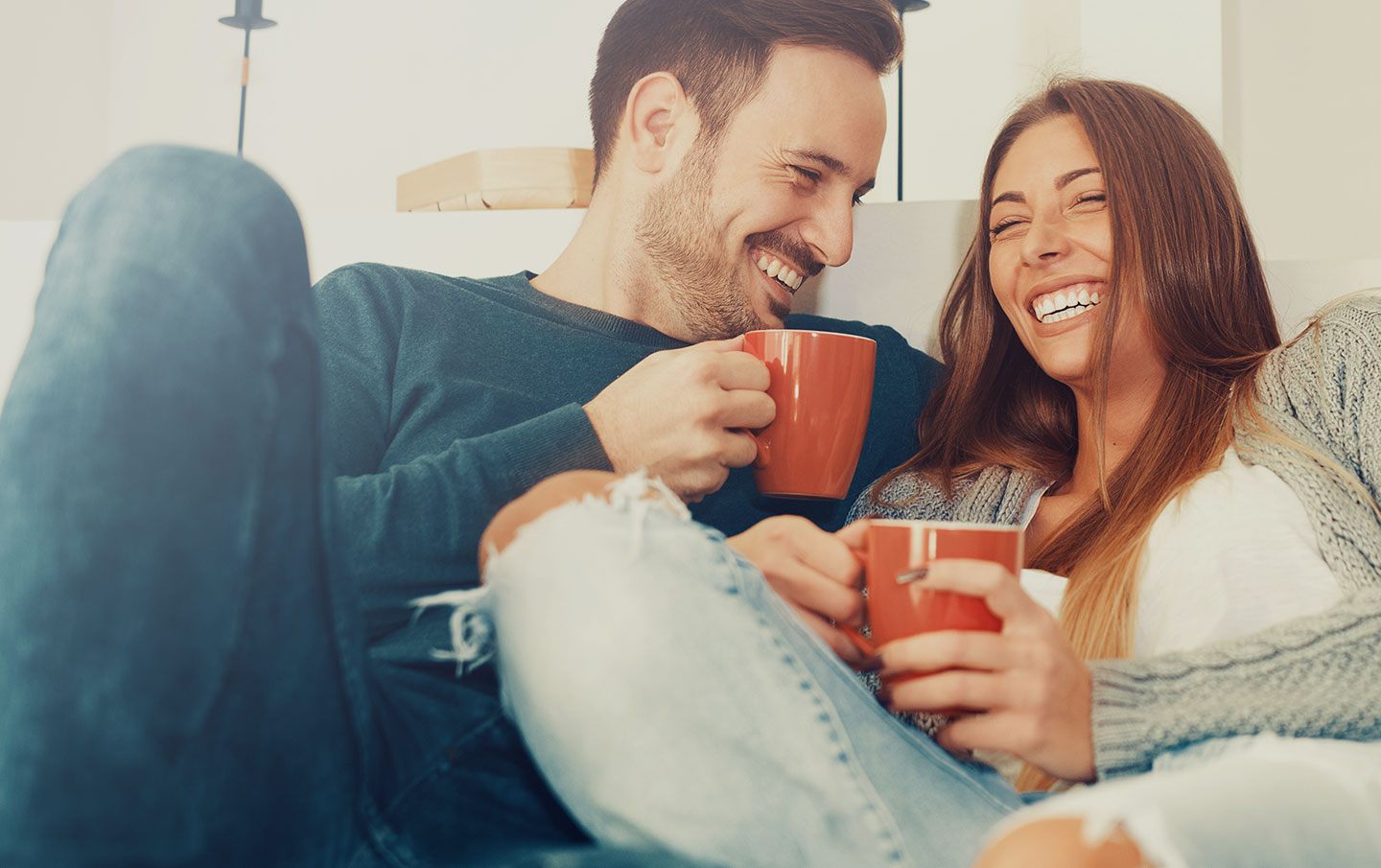 Man and a Woman laughing and enjoying a cup of coffee